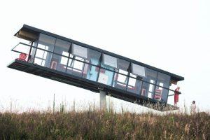 A House mounted on a pivot.